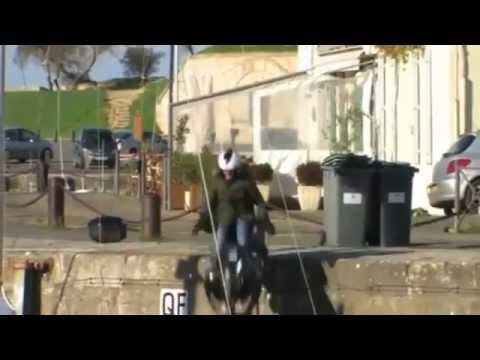 biker falls on a small pier