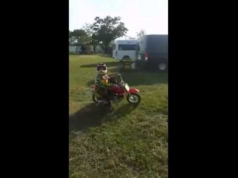 Little boy on a motorcycle stunt shows