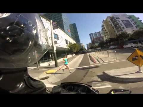 Motorcyclist Smashes Into Jogger At Intersection