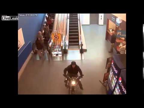 Crazy motorcycle chase through shopping center!