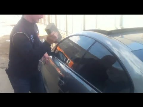 locked out:opening BMW 645 w brick & shovel in Russia