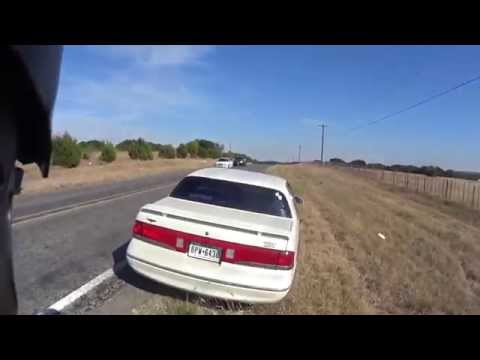 Driver Swerves Into Passing Motorcyclists