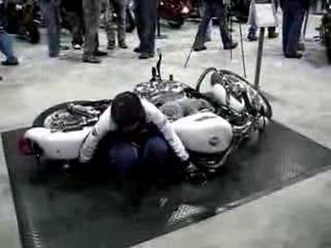 Girl lifting Harley
