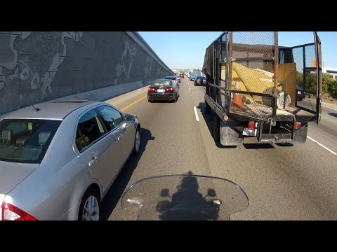 Motorcycle vs Truck Door while Lane Splitting