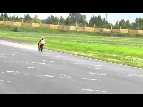 Motorbikes on wet track at Auto24 Ring