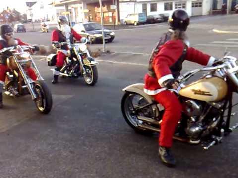 Santa Claus rides Harley Davidson